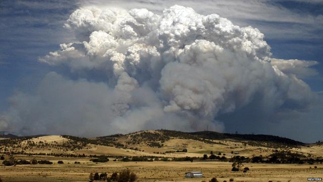Smoke billows high into the atmosphere as fires rage across Tasmania, 6 January 2013. A 'dome of heat' pushed temperatures above 40 degrees, creating 'catastrophic' fire conditions, called 'the worst fire danger the state has ever faced'. Reuters