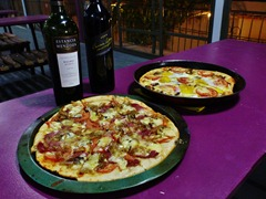 Pizza and wine feast.