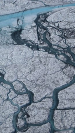 A system of meltwater streams and rivers in the Kangerlussuaq area of the Greenland ice sheet during a record melting year, 21 July 2012. Marco Tedesco