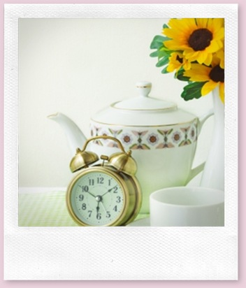 Picture of a tea pot, alarm clock and a cup