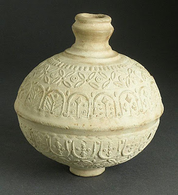 Vessel | Origin: Iraq, Iran, Syria, or Egypt | Period: first half of 8th century | Collection: The Madina Collection of Islamic Art, gift of Camilla Chandler Frost (M.2002.1.81) | Type: Ceramic; Vessel, Earthenware, molded, Height: 5 3/4 in. (14.61cm); Circumference (at widest point): 16 7/8 in. (42.86 cm)