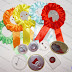 Textile Rosette, Available in Different Colors with round Pin Button Badges 44 or 58 mm. Avalibale color for rosettes: red, dark blue, orange, green, yellow, light blue, dark red, pink.