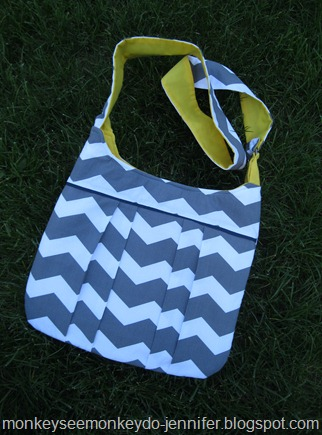 gray and white chevron pleated bag with yellow interior