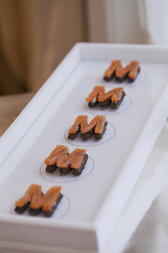 Peter Callahan Catering prepared these m-shaped salmon hors d'oeuvres for the party.