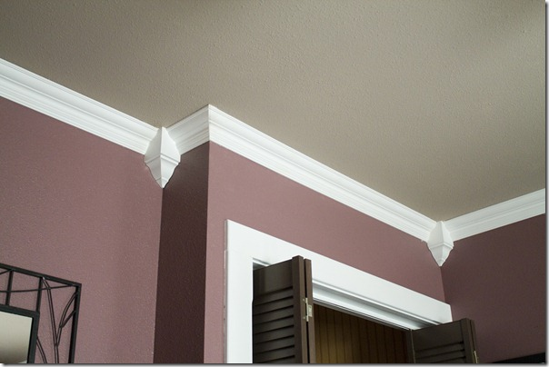 the crown molding installed in the guest bedroom