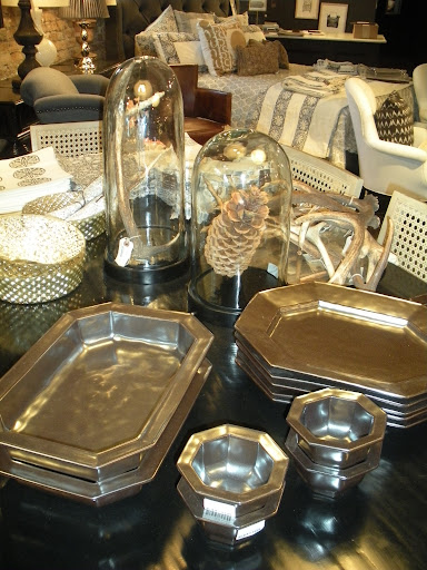Geometric silver platters and bowls break up the usual circle-plate-norm.