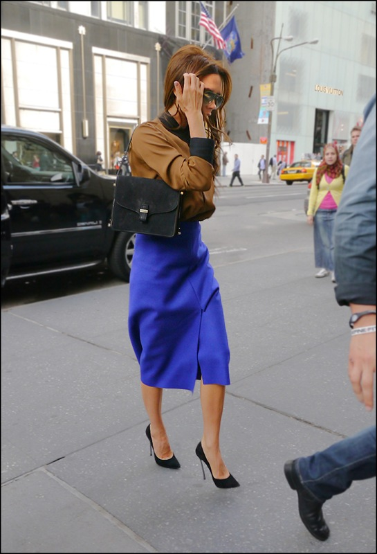 victoria beckham brown shirt with black collar and cuffs blue high waist long slit skirt ol