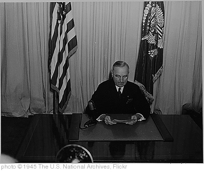 'President Harry S. Truman seated at a desk, before a microphone, announcing the end of World War II in Europe., 05/08/1945' photo (c) 1945, The U.S. National Archives - license: http://www.flickr.com/commons/usage/