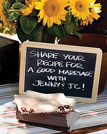 A chalkboard sign encourages guests to write a note, or 