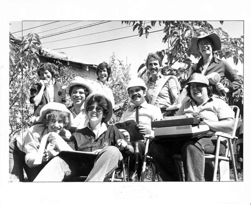 Second staff of the Community Yellow Pages. Standing back row (left to right): Sharon Boaz, Jean Hunter, Dennis, unknown. Seated back row: Boots (typesetter), Phil Gonzalez (circulation), Karn Kircher (managing editor). Front row: unknown, Jeanne Cordova. 1982.