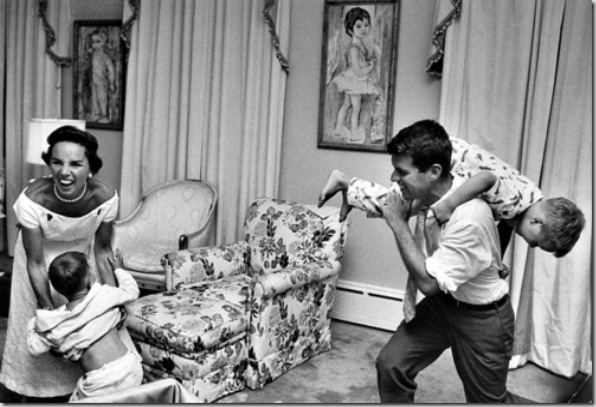 Bobby Kennedy, chief counsel of Sen. Comm. on Labor & Management, carrying his pajama clad young son Joe over his shoulder like a sack of potatoes as his wife Ethel roars w. laughter while trying to fend off another son during bedtime roughhouse, at home.  (Photo by Paul Schutzer//Time Life Pictures/Getty Images)