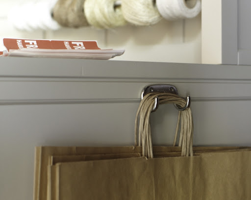 Another great piece of hardware from Sugatsune (sugatsune.com), a double hook.  The two prongs hold shopping bags perfectly.