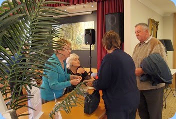 It was all go at the front desk welcoming guests and residents to the Community Music Day. Our Events Manager, Diane Lyons (on the left) and our Secretary, Delyse Whorwood (sitting) took control of the 'command post'. Photo courtesy of Dennis Lyons