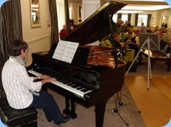 Colleen Kerr playing the Yamaha Grand Piano with expression