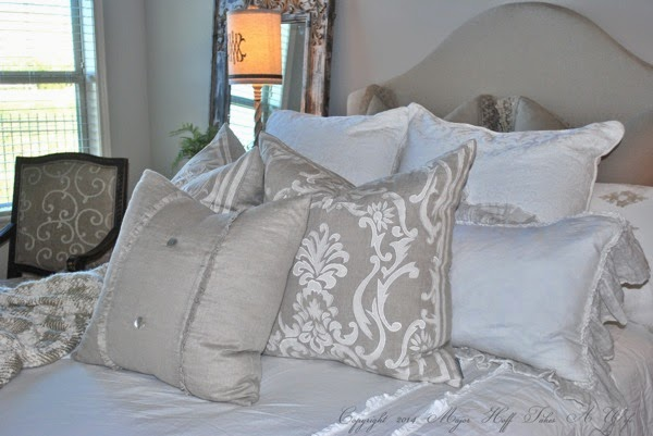 Upholstered headboard with curve and feminine pillows