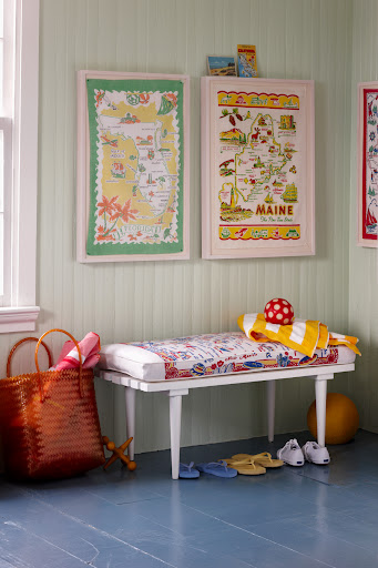 A tablecloth and dish towels have been used to create this bench cover and artwork. (Martha Stewart Living, July 2010)
