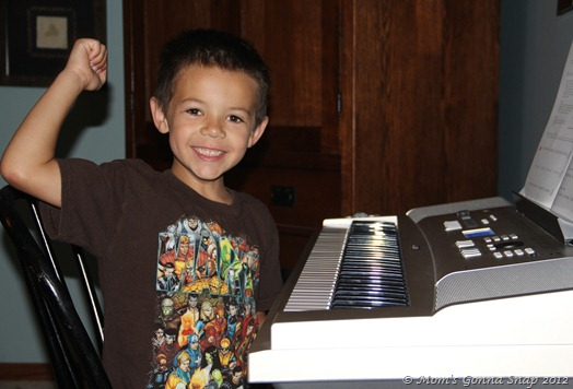 He LOVED his first piano lesson!