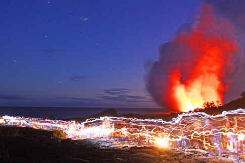 118. OMEARA TOURISTS FLASHLITES TRAILS AS THEY VIEW LAVA KILAUEA