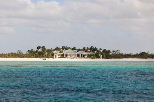 Aren't the clear blue waters and white sand of Parrot Cay stunning?