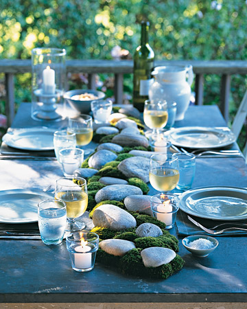 Summer: Whether the materials come from your backyard or a garden center, its easy to incorporate natural elements into the centerpiece of an alfresco dinner. Position stones down the middle of an outdoor table, and intersperse bunches of cushion moss.