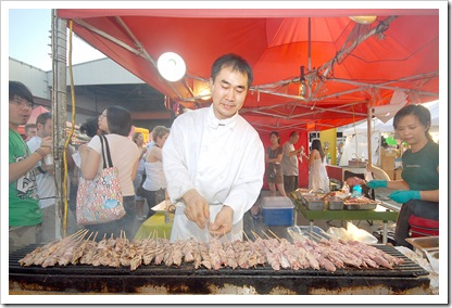 081608 - Richmond, BC Chung Chow photo Richmond Summer Night Market Each weekend throughout the summer 300 vendors selling a wide assortment of products and food items.  The largest venues of its kind attract some 14,000 people. James Chu cooking up satays for the masses.