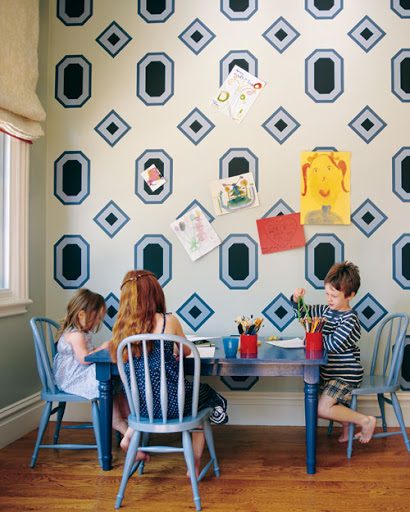 This geometric-pattern mural incorporates magnetic paint in the repeated motif. It's a sophisticated, innovative way to display children's artwork, of which there is a never-ending supply.