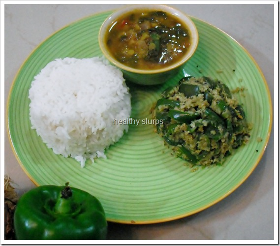 Steamed rice, dal and sir fried Capsicum