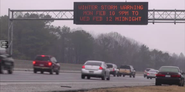 A freeway sign in Georgia announces a winter storm warning for 10-12 February 2014.  President Obama declared a state of emergency in Georgia as the southern state awaited what the National Weather Service called a potentially 'crippling' ice and snow storm 'of historical proportions'. Photo: AP