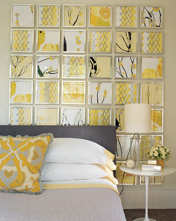 Remnants of four graphic fabrics add drama when placed in metal frames and hung in a grid. The yellow and black really stand out.