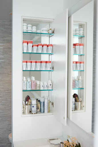 Another great trick is to back the inside of a medicine cabinet with mirror.  It's an easy project with a big impact.