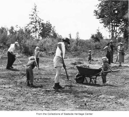 Parents and children raking playfield, Hilltop, May 26, 1951. Eastside Heritage Center Image 1995.12.09. Used by permission.