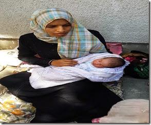 الام صفاء الفرماوي 23 عاما المولود بسام العمر يومين