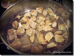 lightly seasoned chicken cubes in pan