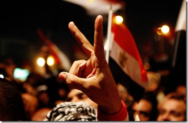CAIRO, EGYPT -- THURSDAY, FEBRUARY 10, 2011 --  An Egyptian protestor holds up a peace sign as hopes were up that President Mubarak would resign during his anticipated speech.  ( Rick Loomis / Los Angeles Times )