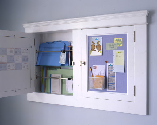 Two medicine cabinets can be outfitted as a office. The doors have been fitted with metal and homasote covered in linen to make a pin board and magnet board. Inside, files and supplies are stored.