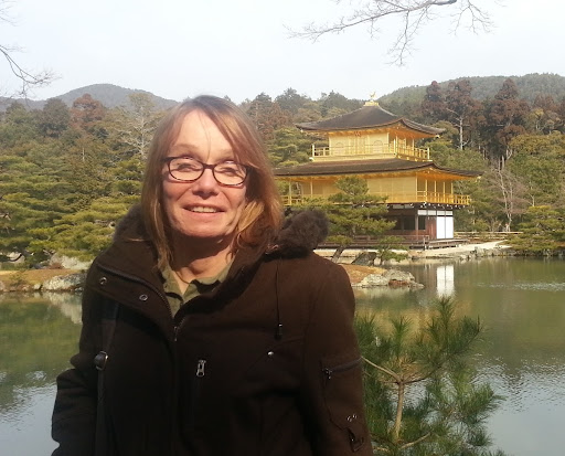 Me, in Kyoto, 4 months post-transition, squinting into the rising sun.