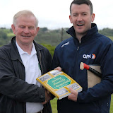 2/7/2012 ECHO SPORT  John Twomey seen presenting Cork senior hurling goalkeeper Donal Og Cusack a copy of 'The Sporting Shamrocks of Ringaskiddy' following his recent visit to Camp Ciaran at the Shamrocks GAA Club (Pic Howard Crowdy)