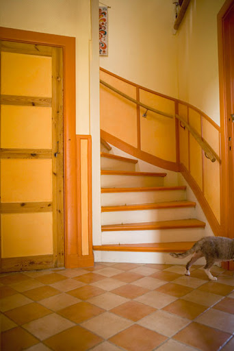 If you're comfortable with bright paints, go all out! With orange, entryways that offer good light allow multiple shades to meld gently. (www.designsponge.com)