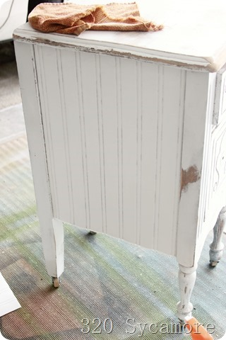 beadboard wallpaper on side of nightstand