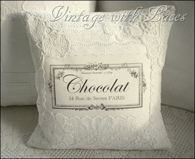 White pillow with vintage French graphic