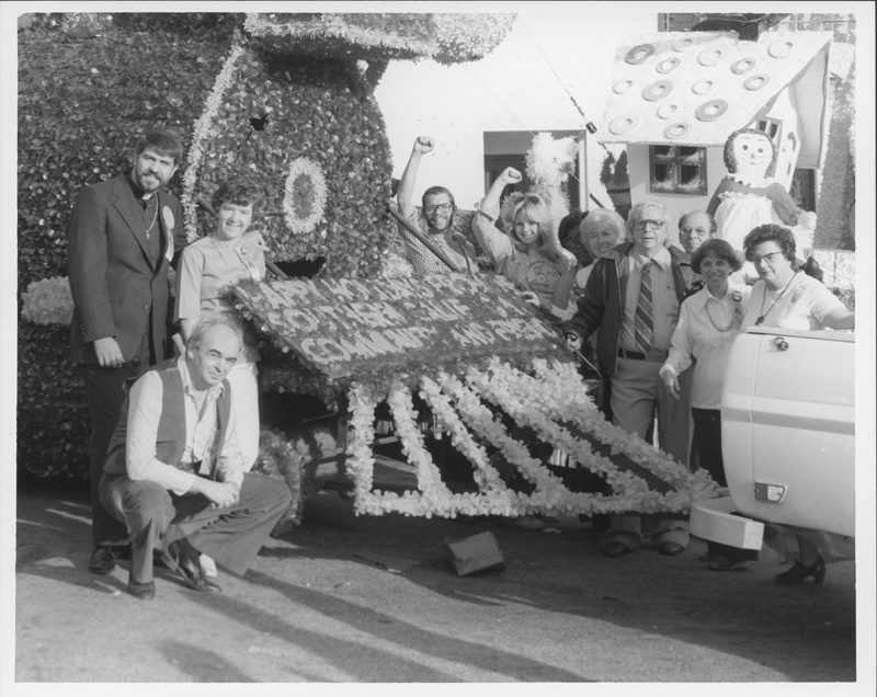 The Human Rights Train becomes the first float sponsored by an LGBT organization in the Hollywood Santa Claus Lane Parade. People include Reverend Troy Perry, Sharon Cornelison, Jim Kepner (left) and Roy Zukeran [behind women], Morris Kight, Al Gordon, Adele Starr, and Edith Allen Perry (right). November 1977.