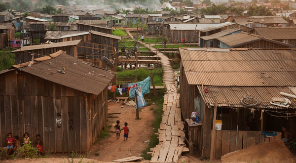 Cities encroach on the Amazon rainforest. The torrid growth is visible in places like Parauapebas. On the outskirts, slums stretch to the horizon and houses continue to go up. Lalo de Almeida for The New York Times