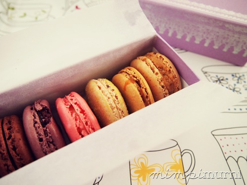 6 little exquisite macarons. From left to right, Blackforest, Blackcurrant + Violet, Rose, Vanilla, Caramel + Salted Butter &amp; Praline. My all time favorite is the Caramel with the Rose coming in a close second. Yummmm.