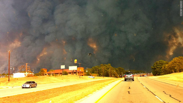 Smoke billows from a wildfire in Bastrop County, Texas, on Sunday, 5 September 2011. Wendy Moore / CNN