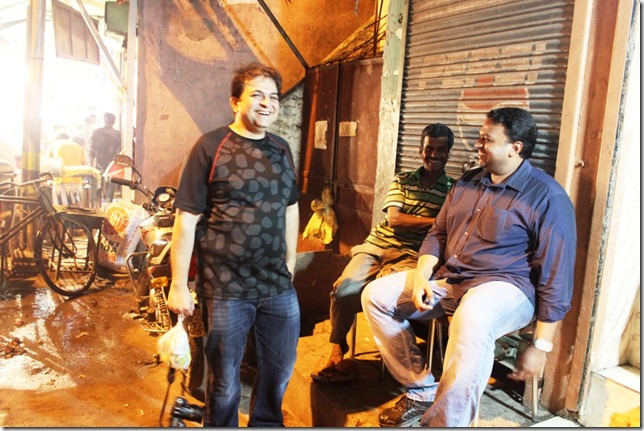 Anurag in the black tee chatting with another satisfied Nizamuddin customer