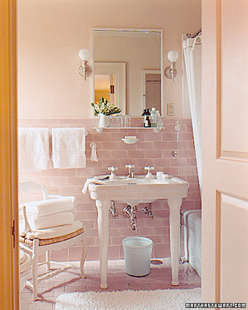 The chair and soft pinks and blues in one of Martha's bathrooms at Skylands are beautiful, and they cast a lovely glow that looks good on everyone.