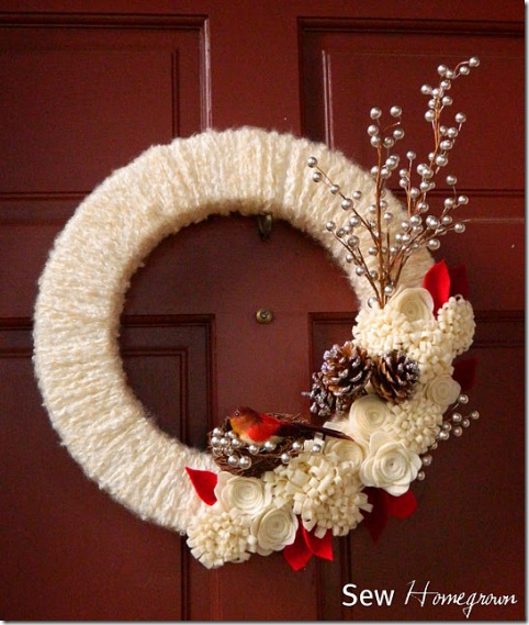 Winter wreath--yarn wrapped wreath with flowers, stems, bird in nest