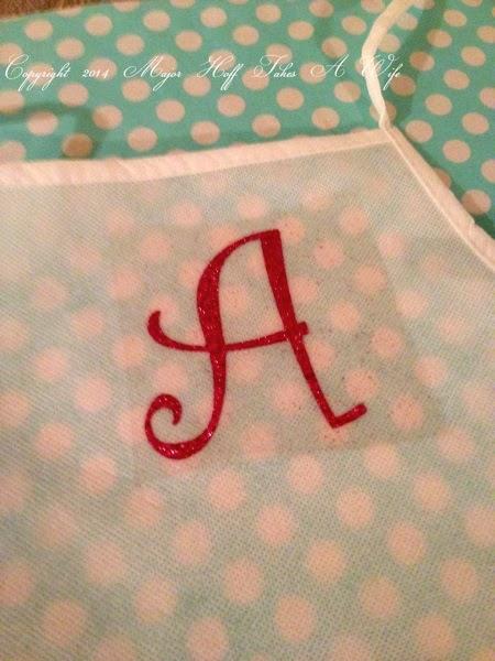 Iron on glitter cricut letter to apron