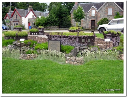 A floral recreation of Urquhart Castle on the banks of Loch Ness.