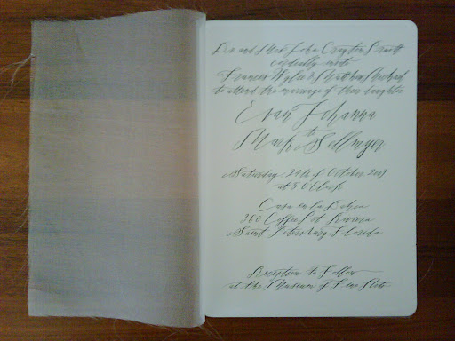 And here, shown with the fabric pulled aside to reveal the calligraphed invitation, designed by Hello!Lucky.
